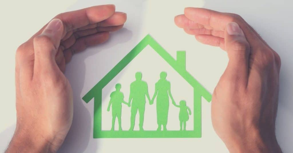 Hands covering a green colored family design inside a home that are discussing the probate process in Texas