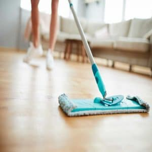 A woman cleaning her house and Preparing Your House For Sale
