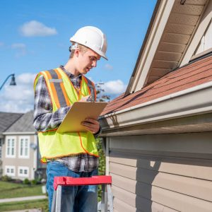 Man inspecting a roof for homeowners Preparing Your House For Sale