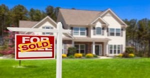 Preparing Your House For Sale. SOLD sign in front of house